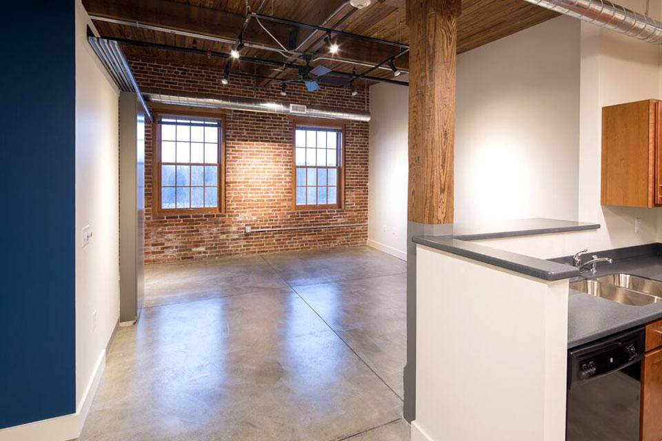 the hawks interior kitchen and living room exposed brick wall