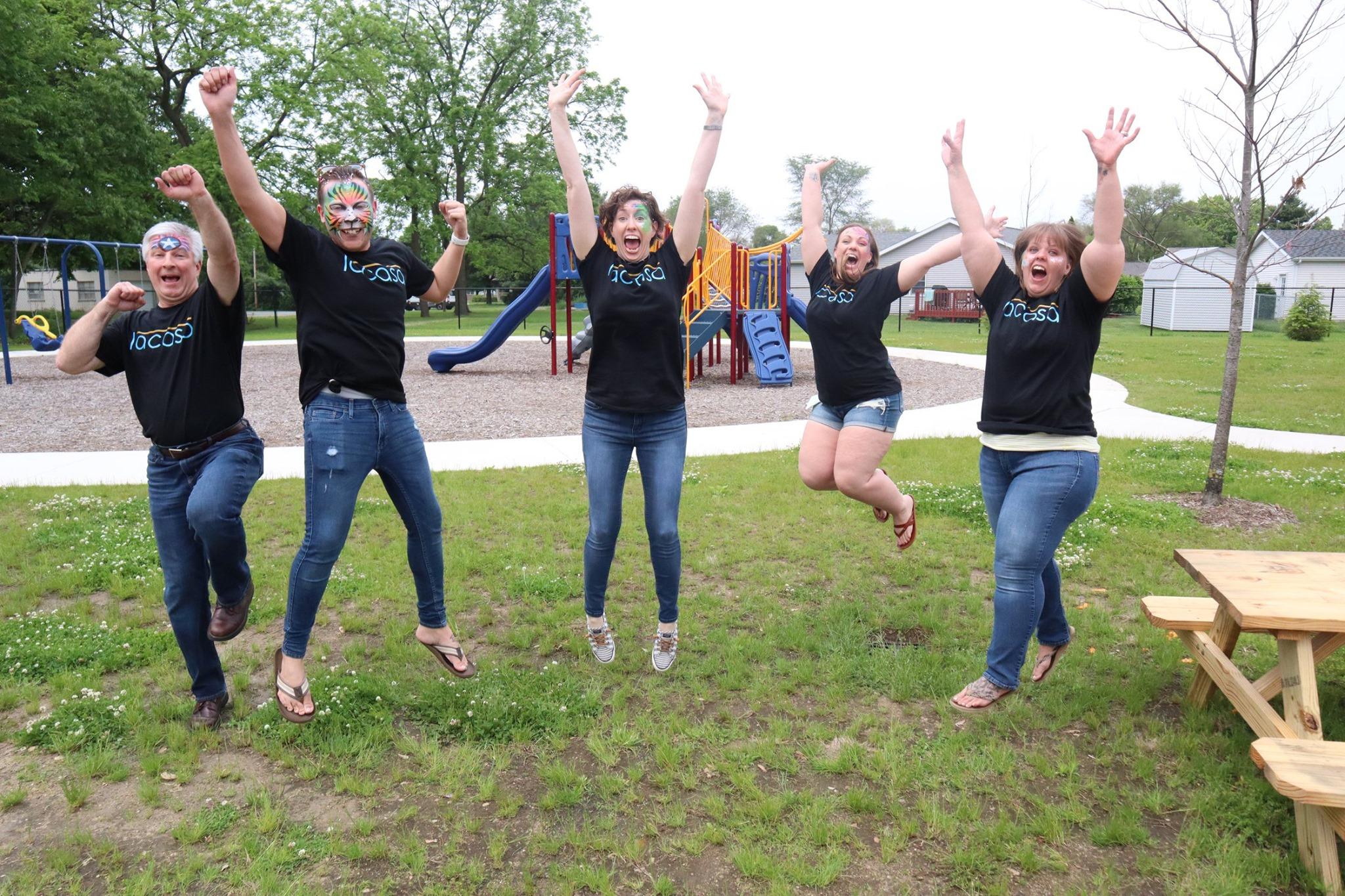 Lacasa volunteers celebrating