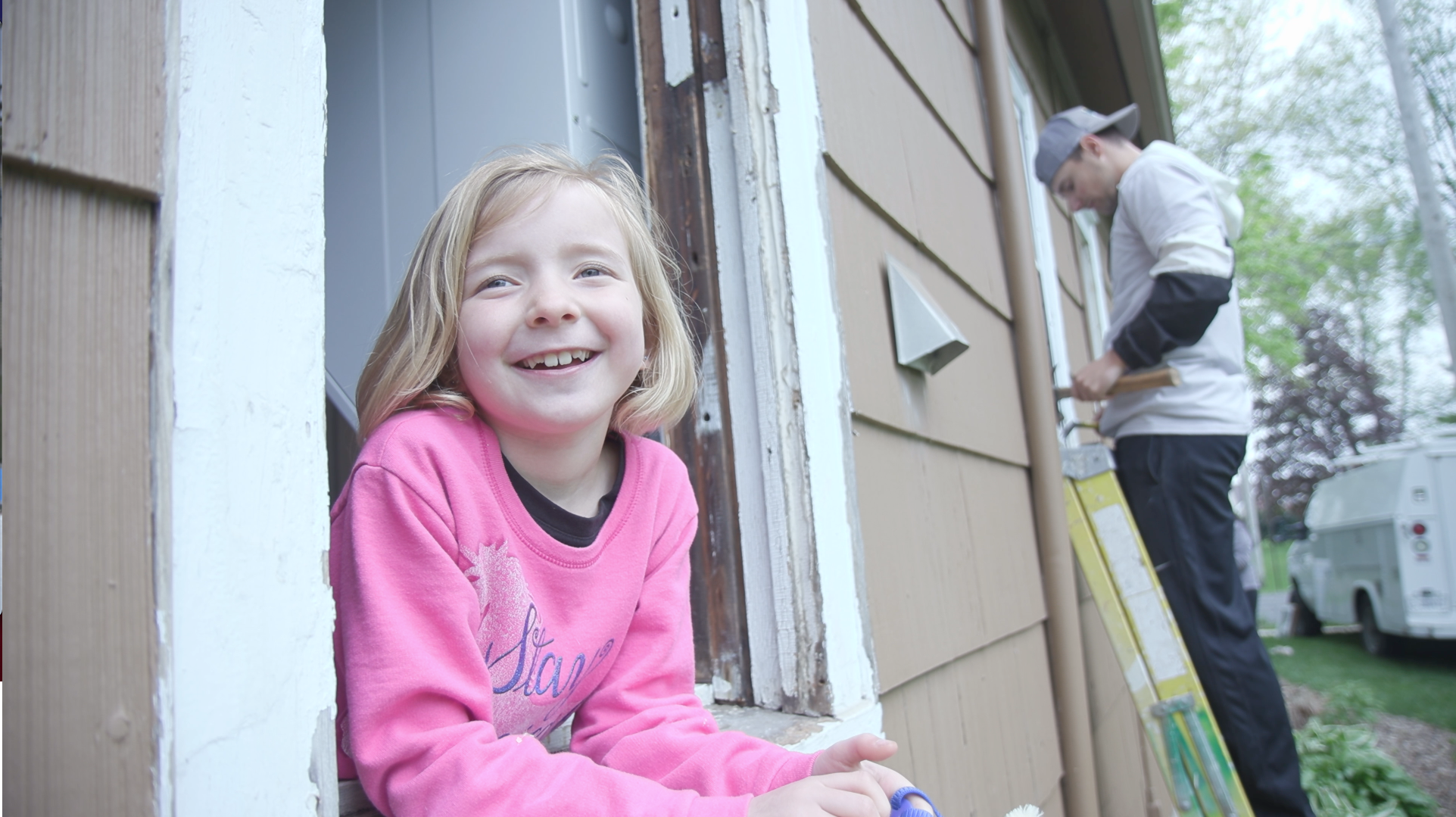 Young girl happy outside home